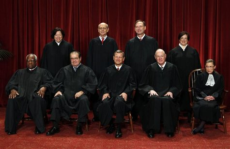 Front row from left: Thomas, Born Catholic, appointed while Episcopalian, returned to Catholic Church in late 1990s/ Yale; Scalia, Catholic/ Harvard; Roberts, Catholic/ Harvard; Kennedy, Catholic/ Harvard; Ginsburg, Jewish/ Columbia. Back row, from the left: Sotomayor, Catholic/ Yale; Breyer, Jewish/ Harvard; Alito, Catholic/ Yale; Kagan, Jewish/ Harvard.