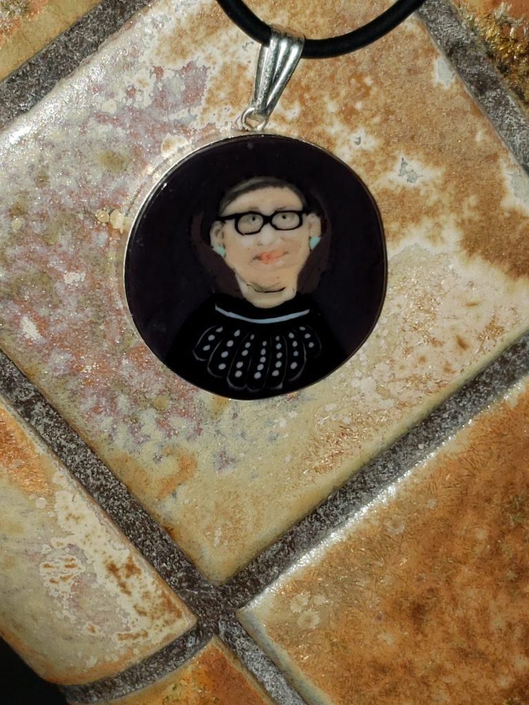 Glass pendant by Jodie McDougall using the ancient technique of fusing glass 'canes'.