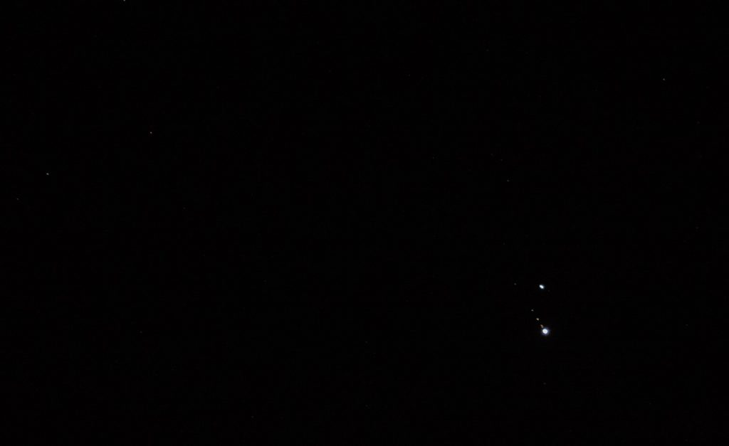 Saturn (above) & Jupiter (below) a Few Days From Conjunction. The star Altair is to upper right and the star Formalhaut is out to the left. Four moons of Jupiter are visible at the 11:00 o'clock position.